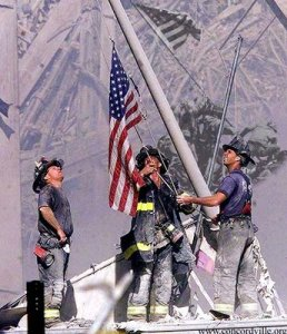 911 firefighters erect flag